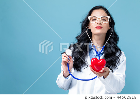 Medical doctor with a stethoscope and a heart concept 44502818