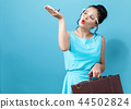 Young woman with a suitcase and toy airplane travel theme 44502824