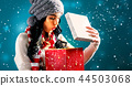 Happy young woman with Christmas present box 44503068