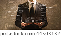 Technology screen with grid with businessman holding a tablet co 44503132