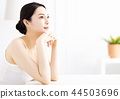 Beautiful young woman with clean perfect skin 44503696