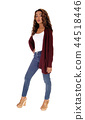 Tall young woman standing in jeans 44518446