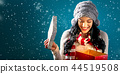 Happy young woman with Christmas present box 44519508