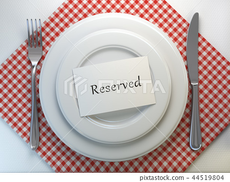 Reserved card on a restaurant table setting 44519804