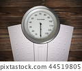 Analog weight scale on wood floor. 44519805