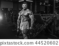 Handsome model muscle man abs workout in gym 44520602