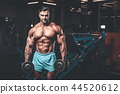 Handsome model muscle man abs workout in gym 44520612