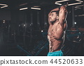Handsome model muscle man abs workout in gym 44520633