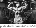 Handsome model muscle man abs workout in gym 44520659