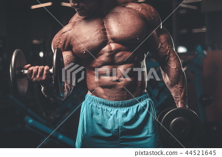 Handsome model muscle man abs workout in gym 44521645