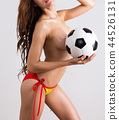 Young sexy woman with soccer ball 44526131