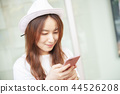 Young Woman Use Of Mobile Phone In Shopping Mall 44526208