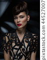 beautiful young woman with fancy hairdo and red lips 44527007