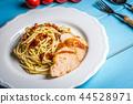Italian spaghetti with chicken and sundried tomato 44528971