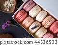 Close up colorful macarons dessert with vintage pastel tones on wooden background 44536533