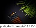 Dark background with make-up brushes 44543355