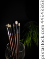 Brushes in glass with glass 44543363