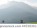 Road signs in misty mountains 44556301