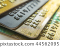 Gold and platinum credit cards close up 44562095