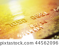 Gold credit cards close up. Macro shot smart card, credit card. 44562096