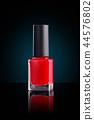 Red nail polish. 44576802