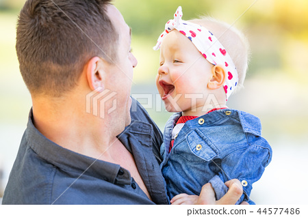 Young Caucasian Father and Baby Girl At The Park 44577486