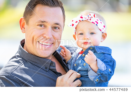 Young Caucasian Father and Baby Girl At The Park 44577489