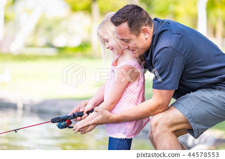 Caucasian Father and Daughter Fishing At The Lake 44578553