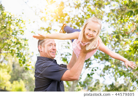 Caucasian Father and Daughter Have Fun At The Park 44579805