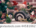 Christmas chocolate roll cake placing with snowman 44581662
