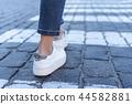 legs at a pedestrian crossing 44582881