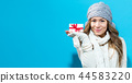 Young woman holding a Christmas gift 44583220