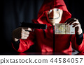 Mystery man holding gun and euro banknote 44584057