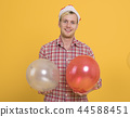 Man have fun in the party with balloon decoration 44588451
