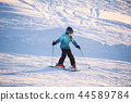 Morning walk of a girl in skiing in the mountains 44589784