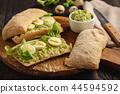 Avocado sandwich ciabatta with quail eggs. 44594592