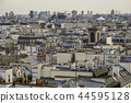 The roofs of Paris and its chimneys under a clouds sky 44595128