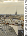 The roofs of Paris and its chimneys under a clouds sky 44595176