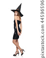 Full length playful Halloween witch on white background 44596596