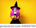 Girl in witch Halloween costume 44600760