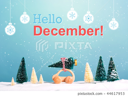 Hello December message with car carrying a Christmas tree 44617953