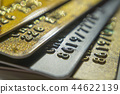 Gold and platinum credit cards close up 44622139
