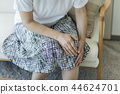 Middle-aged woman Knee pain 44624701