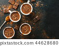 Tasty hot chocolate drink in small cups 44628680