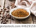 The instant coffee and coffee beans. 44629156