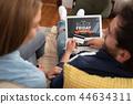 Black Friday promotion sale on laptop screen 44634311