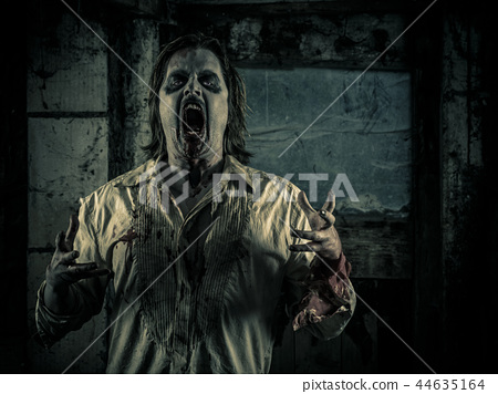 Angry zombie in a dark room hungry for brains 44635164