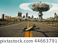 Bomb on the road. Background a nuclear explosion. 44663791