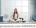 Young beautiful girl hugging a many puppies of a French bulldog 44669026