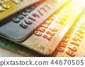 Gold and platinum credit cards close up 44670505